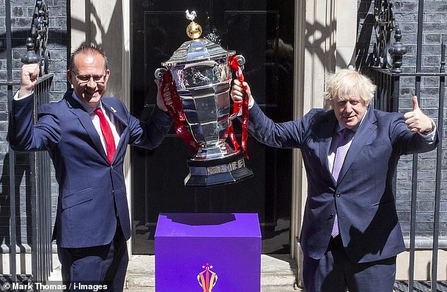 Prime Minister Boris Johnson (right) poses with the Rugby League World Cup trophy last week as excitement grew during the build-up to the tournament