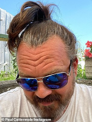 Switch: Paul Cattermole looked unrecognizable from his days in S Club 7 when he took to Instagram on Wednesday to show off his long gray ponytail