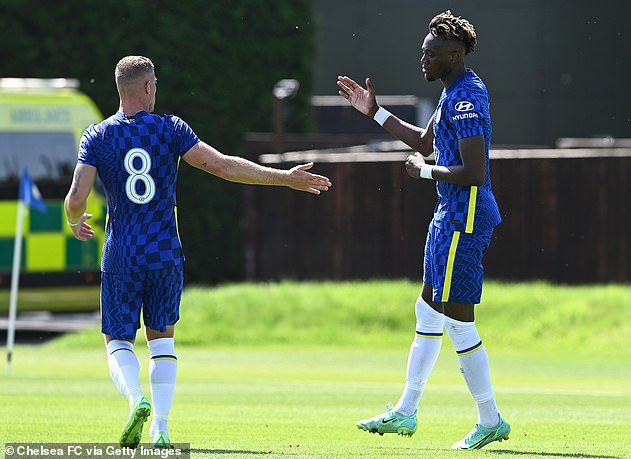 Abraham (right) scored in Chelsea's pre-season game against Peterborough United, but has fallen slightly lower in the pecking order under Thomas Tuchel.