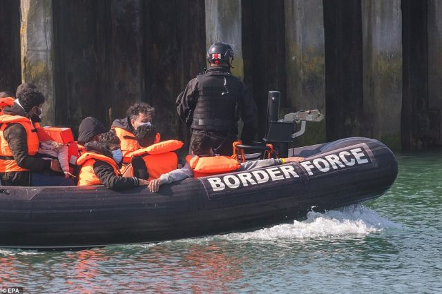 Border Force bring in a group of people thought to be migrants, including children, who were found in the English Channel off the coast of Dover