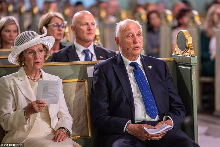 Norway's King Harald and Queen Sonja attend a service at Oslo Cathedral to mark a decade since the country's worst peacetime attack