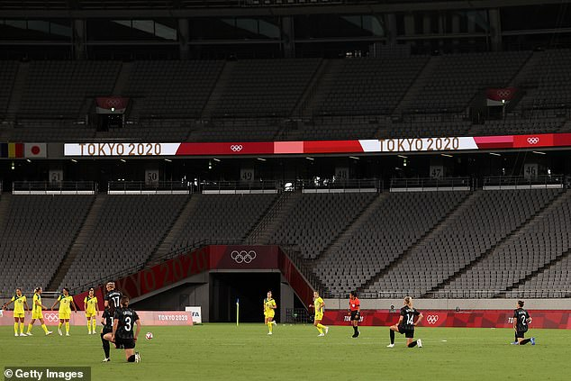 Pictured: Team New Zealand players kneel in support of the Black Lives Matter movement ahead of the Women's First Round Group G match between Australia and New Zealand during the Tokyo 2020 Olympic Games at Tokyo Stadium on July 21, 2021