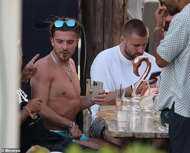Relaxing: England stars Jack Grealish and Luke Shaw enjoyed a party in Mykonos on Wednesday alongside Love Island's Josh Denzel after helping England make Euro history