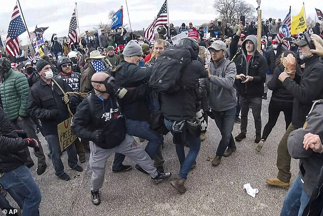 An Associated Press photographer is shown being assaulted by rioters at the Capitol