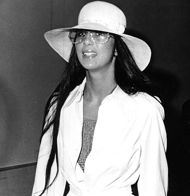 Cher enchanted America with her amazing ensembles.  Here in 1973, she accessorized with diamond-accented sunglasses