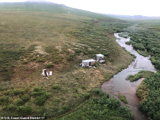 A Coast Guard crew bound for Nome, Alaska, on Friday saw a man in a remote mining camp 40 miles from the city (pictured) waving both arms in a plea for help