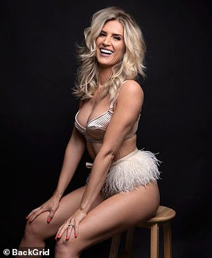 Volume: Sarah worked her angles on the stool and tousled her blonde tresses back and forth as she posed