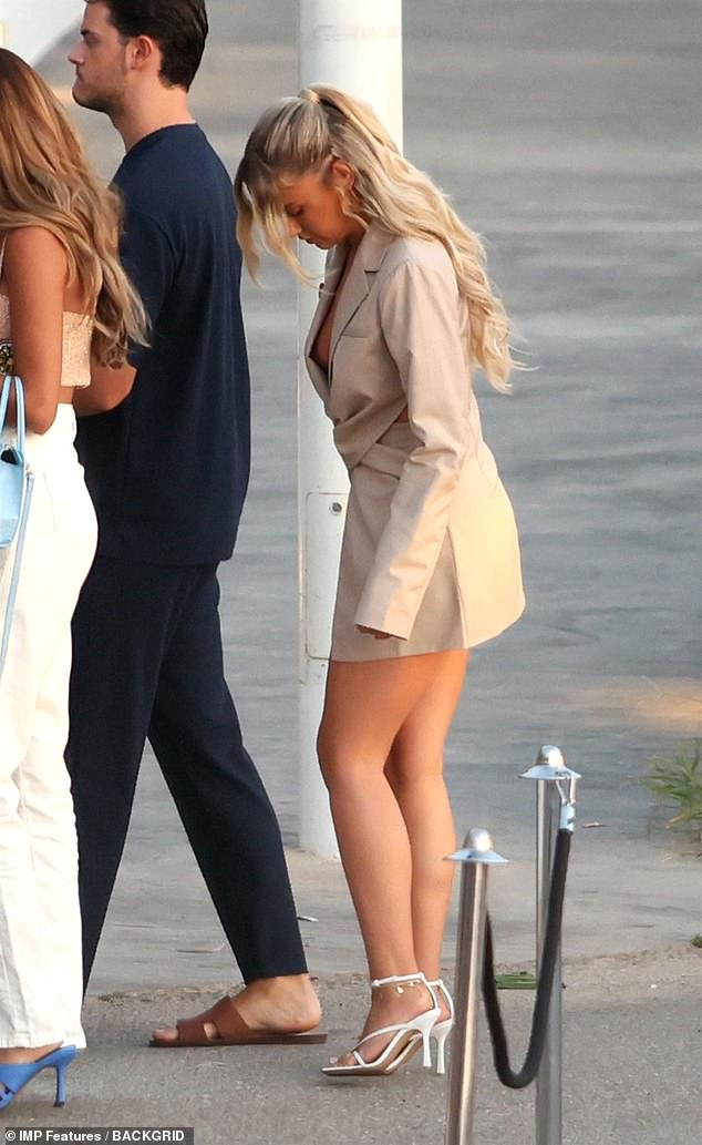 Bronzed: She had clearly been making the most of the Spanish sun as she sported a healthy glow