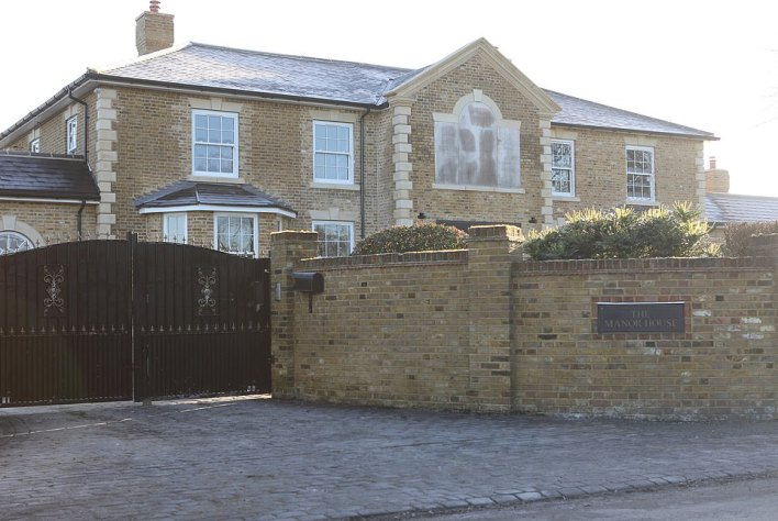 The mansion of Mick Norcross where he was found dead in January.  His son smashed his way in with a hammer after failing to catch him