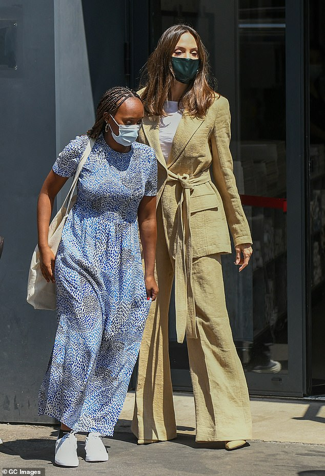 Dressed up: Zahara looked stylish in a blue maxi dress that she paired with white trainers and a reusable tote bag