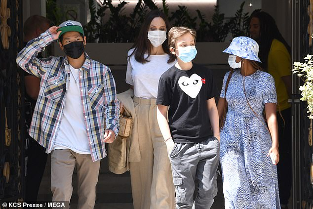 Family: Angelina stayed close to her three children during their outing
