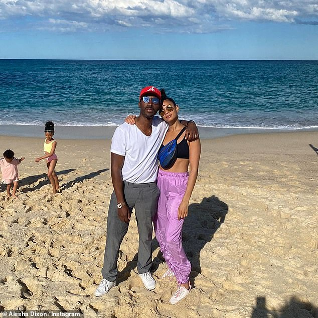 Cute couple: Alesha Dixon flashed her abs in a bikini top and hugged her husband Azuka Ononye as she shared throwback snaps from Sydney on Thursday