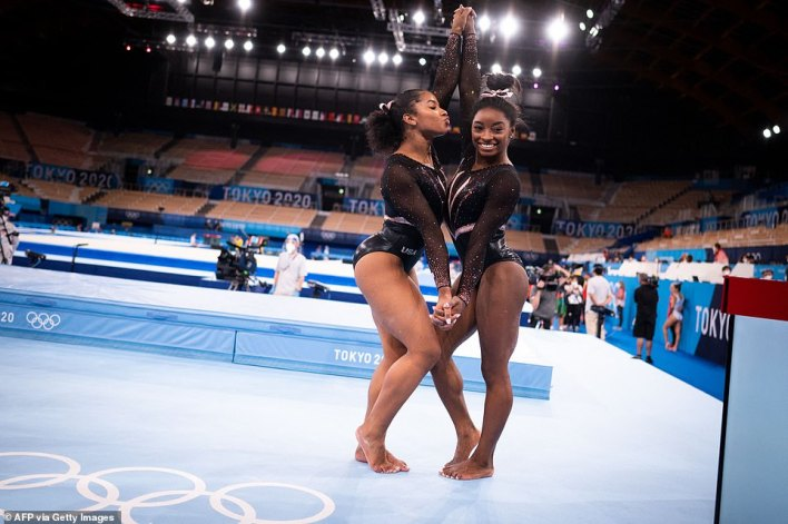 US gymnasts Jordan Chiles (left) and Simone Biles pose after a training session at the Ariake Gymnastics Centre in Tokyo