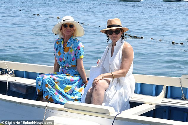Soaking up the shunshine: Sting's wife Trudie Styler looked sensational in a blue floral dress as she joined Gina Gershon in Ischia on Thursday