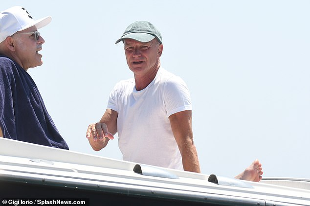 Relaxing: Sting kept things casual in a white T-shirt and shorts as he waited for his wife at sea