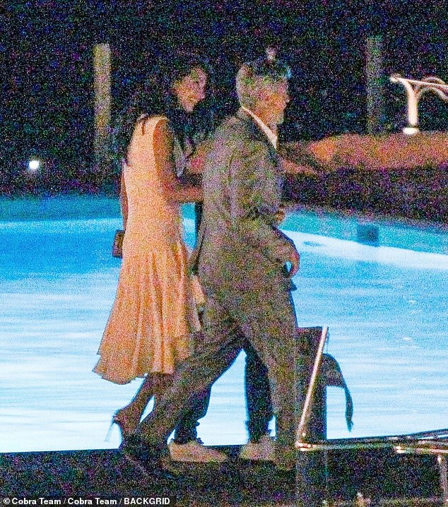 Fun couple: Amal's sister Tala and mother Baria Alamuddin were with the couple for dinner at the Grand Hotel Tremezzo as the group returned by boat