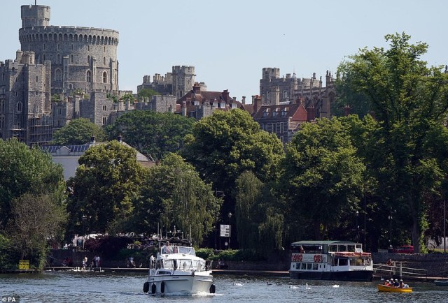 People in boats on the River Thames in Windsor, Berkshire, this afternoon as the heatwave continues