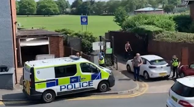 The camera then revolved around the show a police van parked in front of the house, with six officers on the street next to a playing field