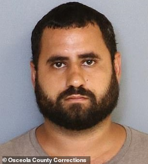 Otero-Rivera is depicted in his mugshot