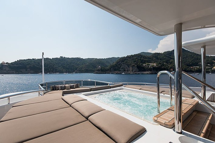 What a life: The outdoor living space is just as enviable, judging by the spacious hot tub submerged in the deck at the back of the luxury yacht