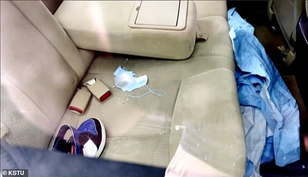 Pictured: The inside of the vehicle where the body of a disabled 9-year-old boy was discovered after being left there for two hours in the parking lot of a Utah healthcare facility