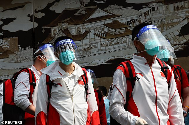 Members of China Team Arrive at Narita International Airport Wearing Anti-Covid Masks