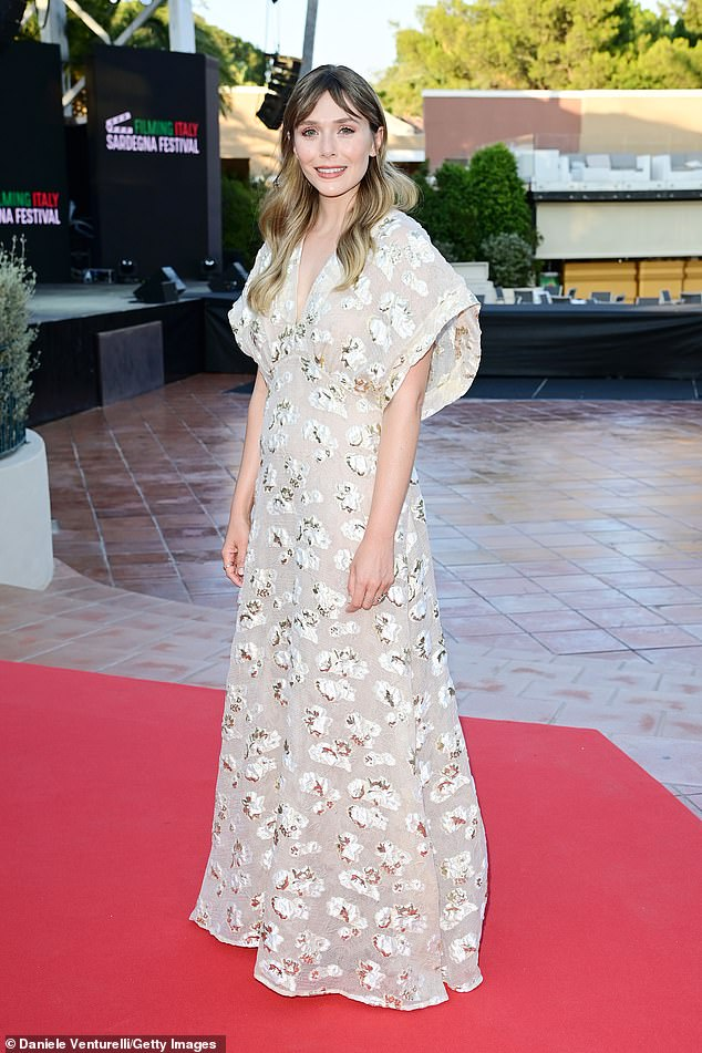 Glam: Elizabeth Olsen looked elegant as she posed for photos at the event, which was held at the Forte Village Resort in Santa Margherita di Pula