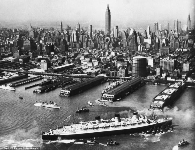 The cruise liner, which took its maiden voyage in 1936, is seen arriving in New York City in 1940