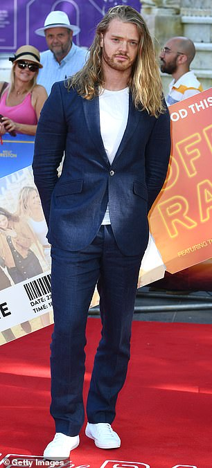 Keeping it cool:The reality star still cut somewhat of a casual figure, pairing his suave suit with a crisp white T-shirt and matching trainers