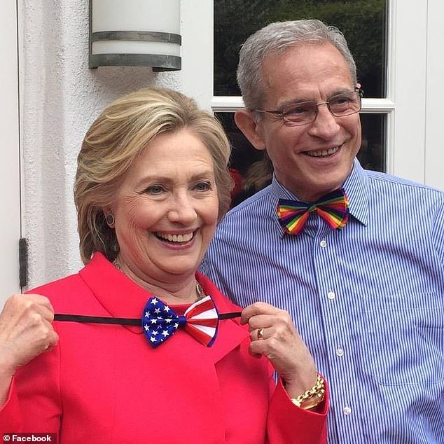 Buck, who has given more than $500,000 to mostly Democratic politicians and causes since 2000, pleaded not guilty to the charges.  He is pictured in 2015 with Hillary Clinton