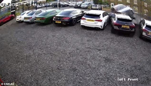 This is the shocking moment when a VW Golf is chased by the police and drives into a luxury car dealership in Huddersfield