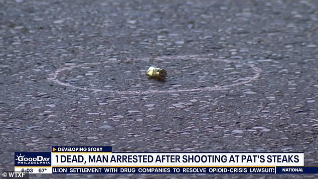 A casing is seen on the ground outside the cheesesteak restaurant after the deadly shooting