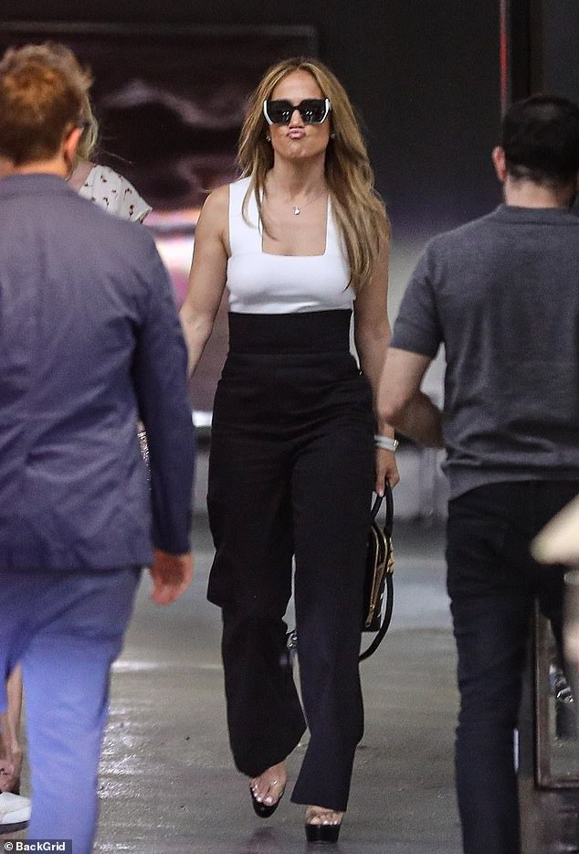 Making faces: The actress, dancer and singer, who turns 52 this Saturday, was seen in a beautiful monotonous ensemble, consisting of a geometric white tank top and black high-waisted pants