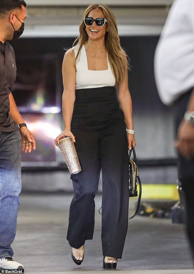 Positively Dizzy: Jennifer Lopez looked so happy on Thursday when she was spotted smiling from ear to ear on her way to a business meeting in her West Hollywood office