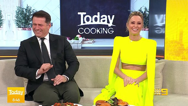 Surprise! Today's Allison Langdon displayed her very toned abs while hosting the Nine breakfast show in 'fancy' dress on Friday. Pictured here with co-anchor Karl Stefanovic