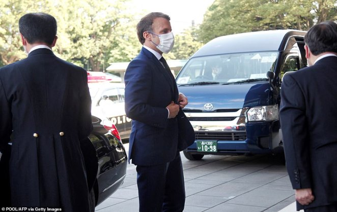 French President Emmanuel Macron is pictured arriving in Tokyo ahead of the Olympic Opening Ceremony, where he will be one of just 15 world leaders in attendance