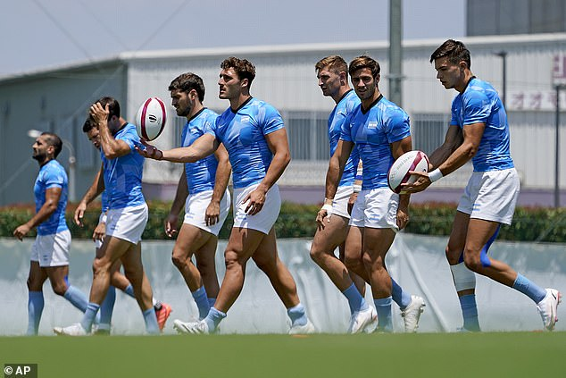 Members of Argentina's men's rugby sevens team warm up on the field during a practice at the Tokyo 2020 Olympics