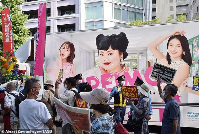 Activists hold a rally ahead of the Tokyo Olympics, delayed from 2020 due to Covid