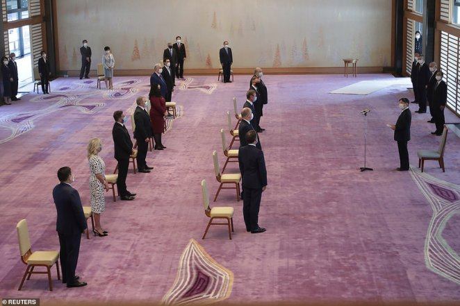 Japan's Emperor Naruhito delivers a speech to the guests including French President Emmanuel Macron and U.S. First Lady Jill Biden at the Imperial Palace ahead of the official opening of the Tokyo 2020 Olympic Games