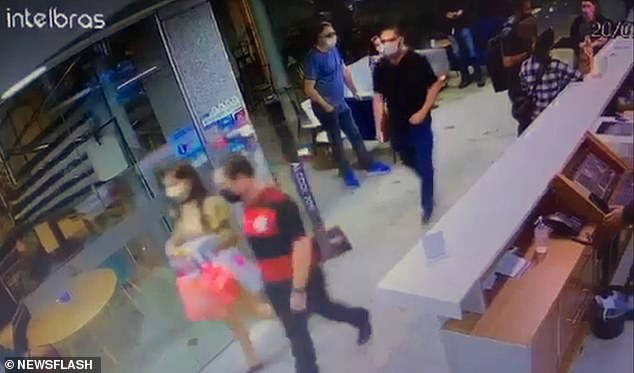 CCTV footage ofFlavia Tamayo's arrest last year has been released showing her being taken by the arm of a plain-clothes police officer (pictured)