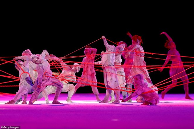 An opening dance routine showed performers entangled in a web of red threads, symbolizing the fear and anxiety that many have been through in the last 18 months