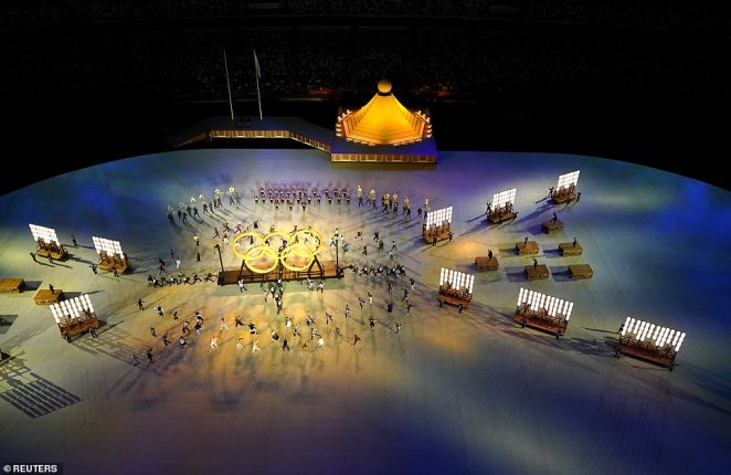 Performers take part in the Olympics opening ceremony in Tokyo on Friday night as the Covid-delayed games got underway