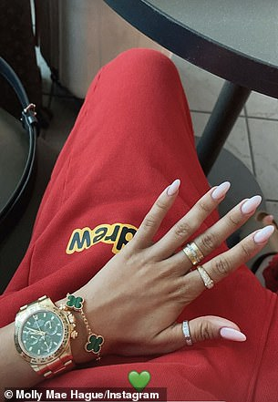 Fancy: On her way to the airport, Molly donned a bright red tracksuit set from House of Drew - Justin Bieber's fashion line and showed off her various jewelry