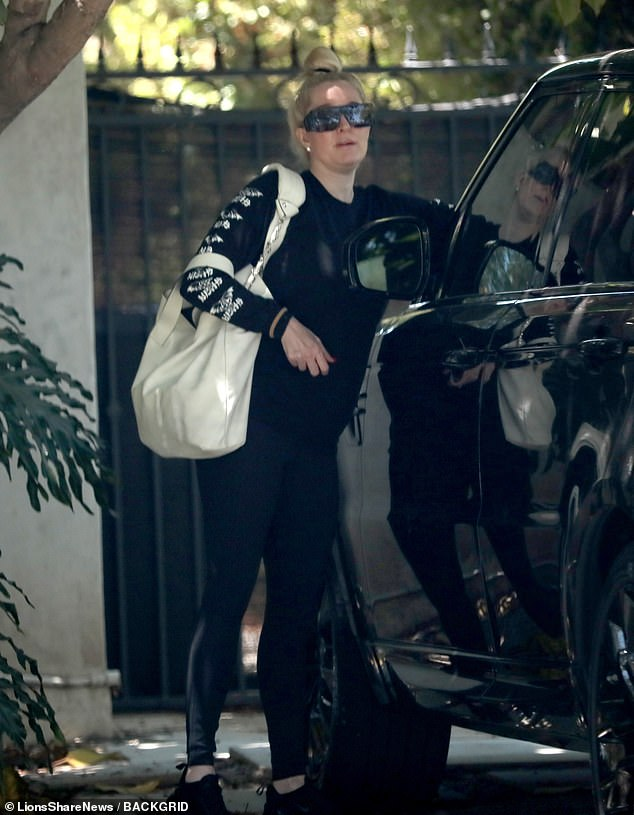 Dancing away from your problems?  Erika Jayne is pictured in Beverly Hills on Wednesday amid her legal woes as she heads to dance class in her Range Rover