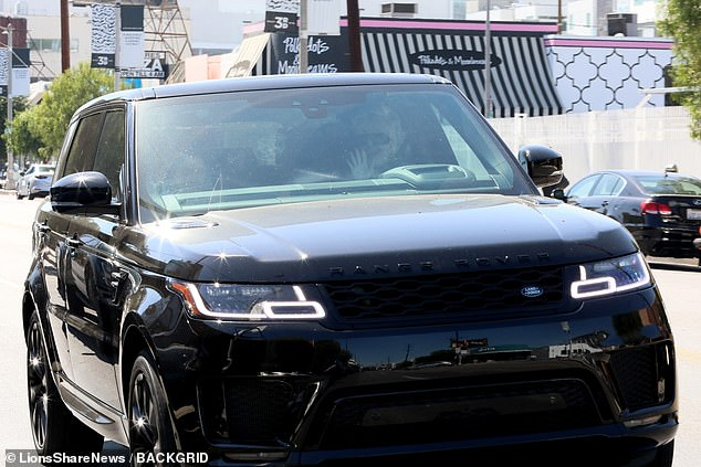 Luxury wheels: the beleaguered reality star left in his Range Rover