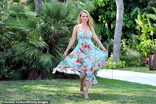 Floaty: Working her best angles, the blonde beauty showed off her flowing gown, lifting it up at the hem for snaps
