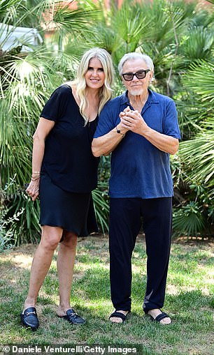 Happy: Tiziana and Harvey beamed as they posed together at the event