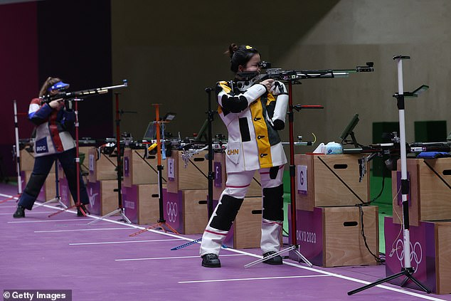 TheChinese star held her nerve to win gold in the women's 10-metre rifle event