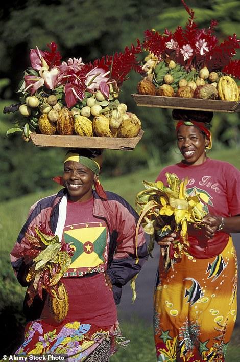 Women carry fruit trays on 'Spice Island' Grenada
