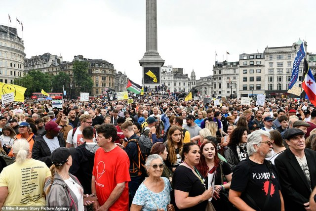 Posing with fellow supporters in Trafalgar Square was far-right commentator Hopkins, who landed back in the UK earlier this week following her deportation from Australia
